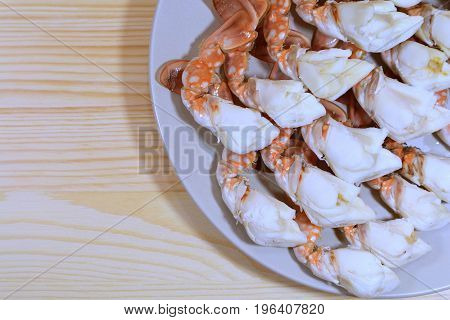 Top View of Delectable Steamed Flower Crab Legs Served on Wooden Table