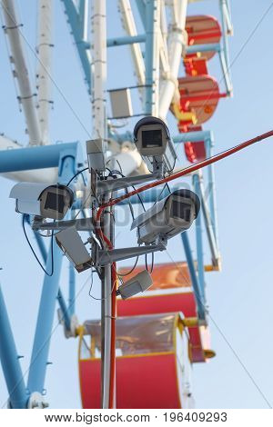 Video camera is monitoring the public order in the amusement park