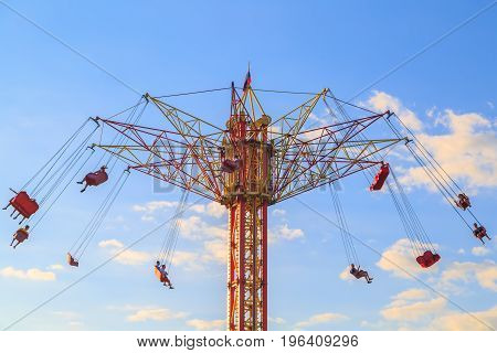High rolling carousel on the background of blue sky