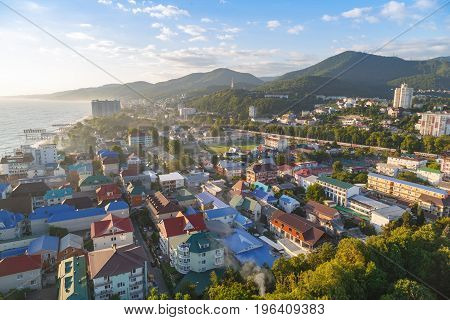 LAZAREVSKOE SOCHI KRASNODAR REGION JULY 5 2017: View of the beach amusement park and center of Lazarevskoe city Sochi at sunset in summer