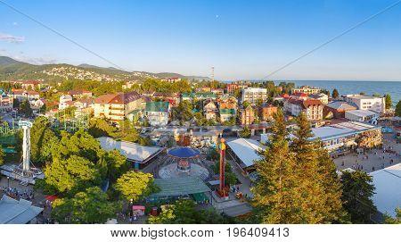 LAZAREVSKOE SOCHI KRASNODAR REGION JULY 5 2017: Panoramic view of the amusement park of Lazarevskoe city Sochi at sunset in summer