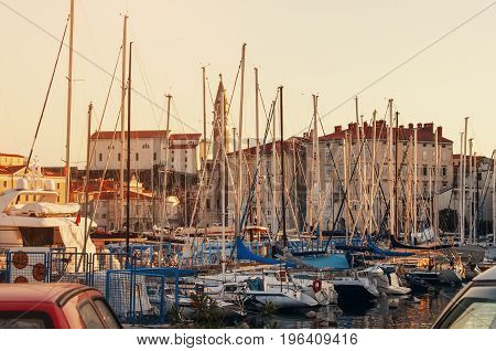 Jetty for mooring fishing boats and yachts on the Mediterranean coast at dawn. Piran, Slovenia.