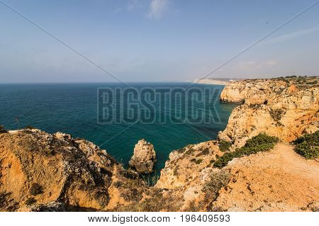 Beautiful View Of Sand Beaches With Rocks Washed By Atlantic Ocean On Sunny Summer Days