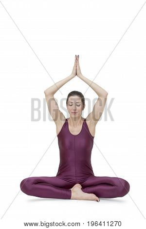 Woman practicing yoga Muktasana pose on the white background