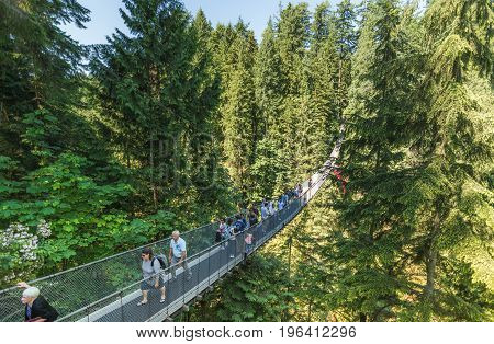 Vancouver, Canada - June 24, 2017: People Crossing The Famous Capilano Suspension Bridge On A Sunny