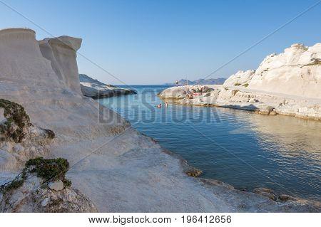 Milos Greece - June 15 2017: Peaople at Sarakiniko beach enjoying the moon-like scenic white rock formations in Milos island