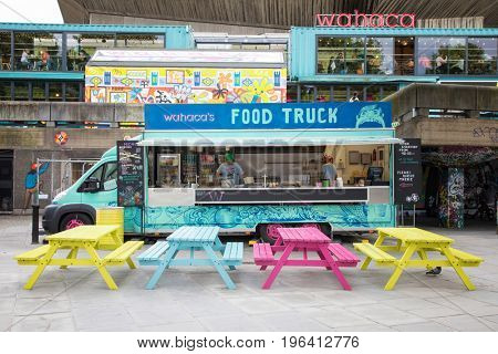 London, UK - 5 June 2017: Colourful food wagon on the Southbank. This is a popular arts area of galleries, theatres, bars and restaurants on the south bank of the River Thames in London.