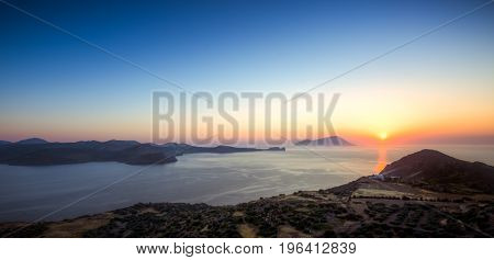 Scenic Sunset As Seen From Plaka Town In Milos Island, Greece