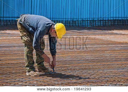 Construction Worker Installing Binding Wires