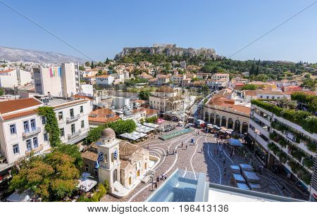 Athens Greece - June 14 2017. People visiting Monastiraki square as seen from a high point of view. Akropolis and Plaka in the background
