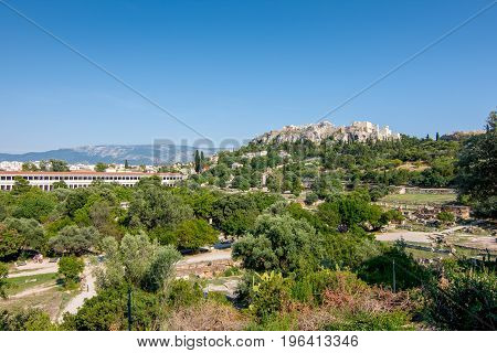 Ruins Of The Ancient Agora (forum) Of Athens With Acropolis In The Background