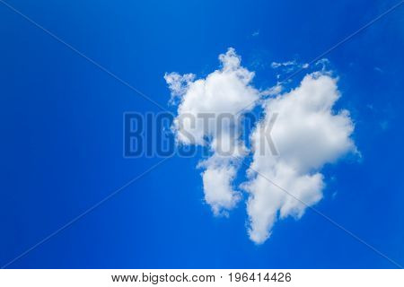 Clouds like broken heart on blue-sky background
