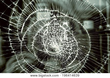 Broken glass abstract pattern. Damaged window closeup background