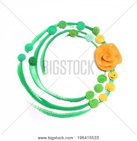 Green frame with flowers made of plasticine