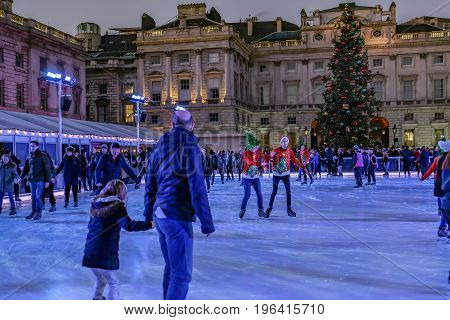London England UK - December 29 2016: Ice-skating at Somerset House in Christmas week with skaters enjoying the experience.