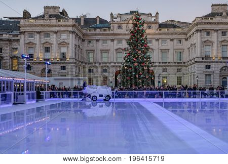 London England UK - December 29 2016: Ice-skating rink ready for the next session at Somerset House. Taken at early evening on a bright winter's day.