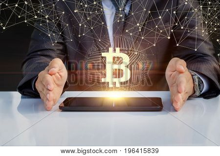 Businessman Shows Bitcoin On A Tablet .