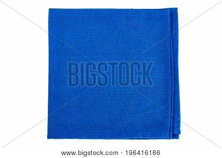 Folded blue textile napkin isolated on white background
