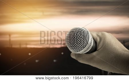 smart hands businesswoman speech sing a song and talking with microphone in seminar conference meeting hall with light color background