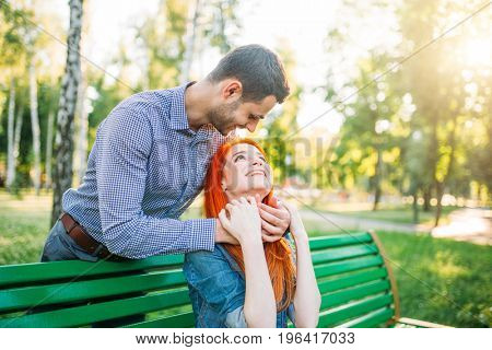 Romantic date of love couple in summer park