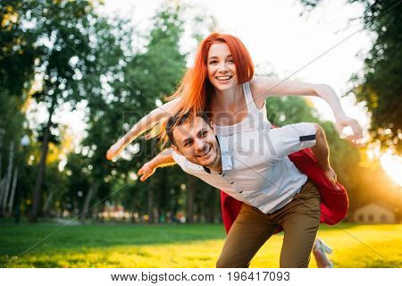 Young couple funs together in summer park