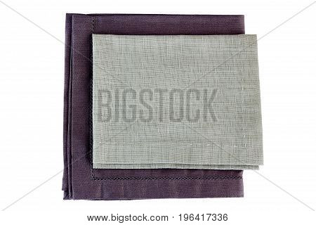 Two folded gray textile napkins isolated on white background