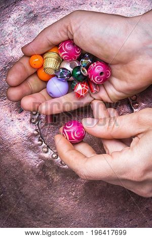 Beads In The Palms Of The Hands