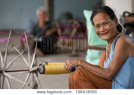 villagers of Ban Sanuan Nok Buriram Province. Thailand - April 30 2017: old women weaving traditional thai fabric at Burirum Thailand. The local silk cloth is characterised by elaborate patterns and design