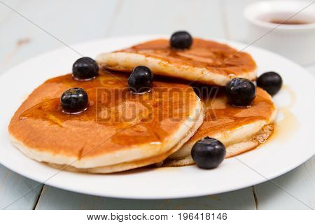 blueberry pancakes Stack of pancakes with fresh blueberry and maple syrup