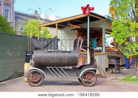 KYIV, UKRAINE - MAY 0,1 2017: Old car in food cout on sale of meal and drink located in Fan Zone of the international Eurovision Song Contest 2017 near Sofia square