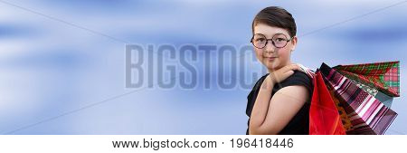 Little Girl With Shopping Bags On Blue Background. Shopping