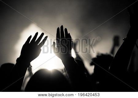 crowd with raised hands at concert - summer music festival