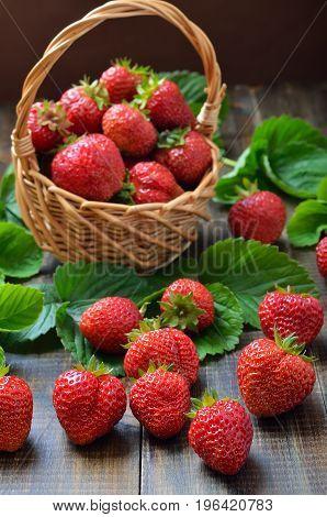 Fresh strawberries on wooden table. Summer berries.