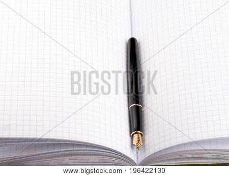 image of one fountain pen on paper notebook