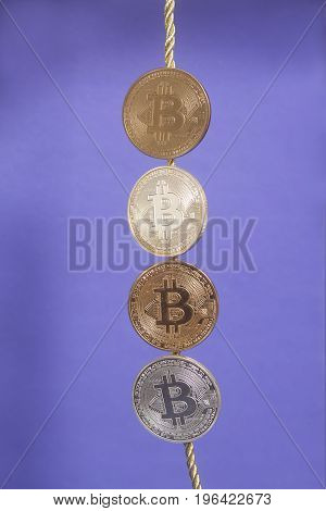 Four Virtual Coins Bitcoins On Violet Background