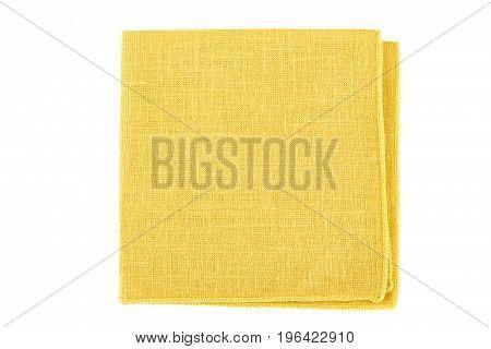 Folded yellow textile napkin isolated on white background