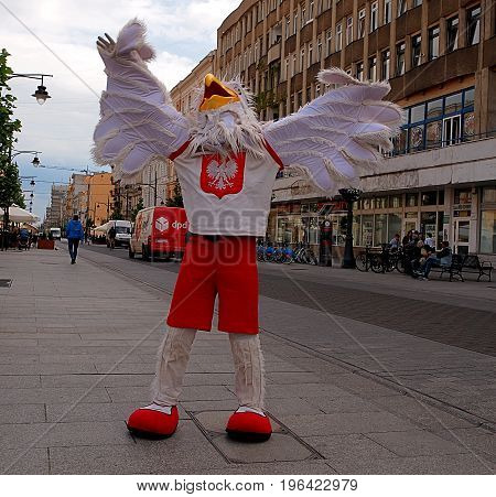 Joy of the eagle .. Lodz, Poland - June 13, 2017 Eagle, mascot of the Polish national team in volleyball on Piotrkowska Street in Lodz.