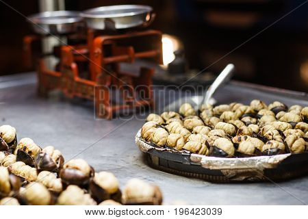 Street stands with roasted chestnuts Turkey roast chestnuts night street