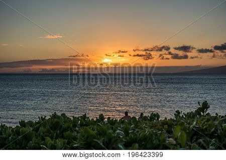 A view of Lanai from a beech in Maui Hawaii. The sun has set.