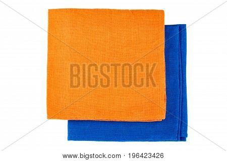 Folded orange and blue textile napkins isolated on white background