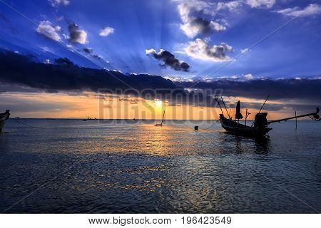 Dramatic Sunset With Local Boat In Thailand
