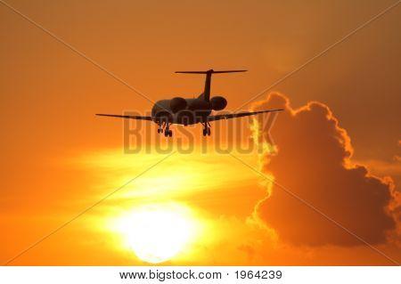 Airplane And Beautiful Sunset