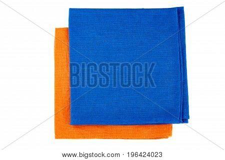 Folded blue and orange textile napkins isolated on white background