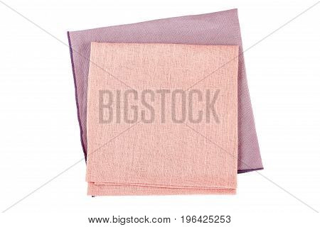 Folded purple and pink textile napkins isolated on white background