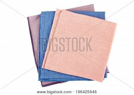 Stack of three colorful textile napkins isolated on white background