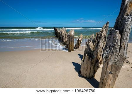 Old wooden breakwater over the Baltic Sea on a sunny day