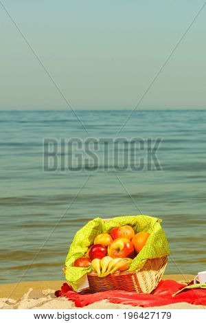 Picnic Basket On Blanket Near Sea