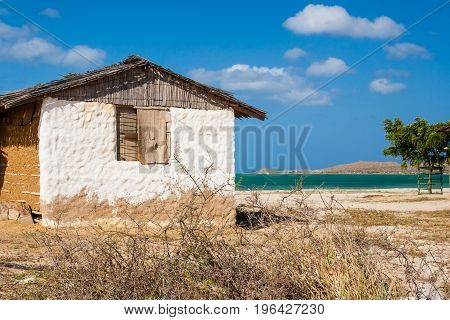 Traditional Adobe House Next To The Sea Under Blue Sky