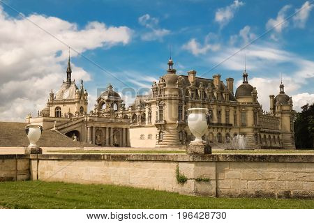 Castle of Chantilly at sunny day, France. The Conde Museum in the castle has one of the oldest collections of historic art in France.
