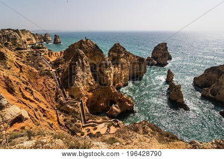 Beautiful Cliffs On Atlantic Coastline With Turquoise Ocean Wave Erosion Caves Background
